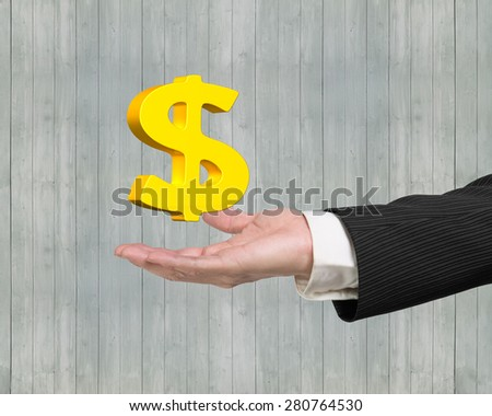 Golden dollar sign in the male hand - stock photo