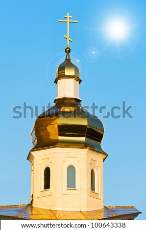 Golden dome of Orthodox Church on the blue sky - stock photo