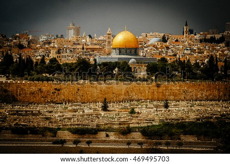 golden Dome of the Rock and church steeples on the skyline of the Old City of Jerusalem.