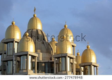 Golden domes of church illuminated by the sun - stock photo