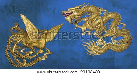 golden dragon and golden phoenix on blue stain wall background - stock photo