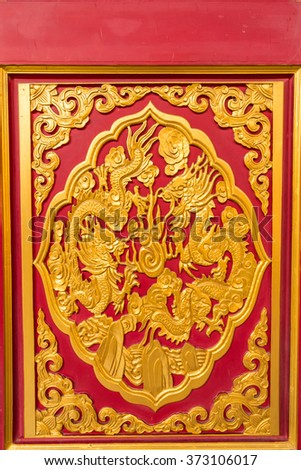 Golden dragon decorated on wood carved on red door, Chinese style in Dragon Temple Kammalawat (Wat Leng Nei Yi) in Nonthaburi, Thailand
