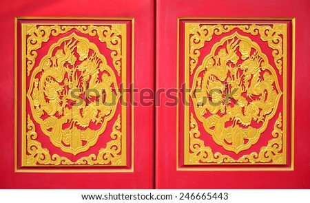 Golden dragon on the red door of Chinese temple in Thailand