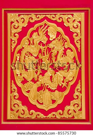 golden dragons in chinese style on red background
