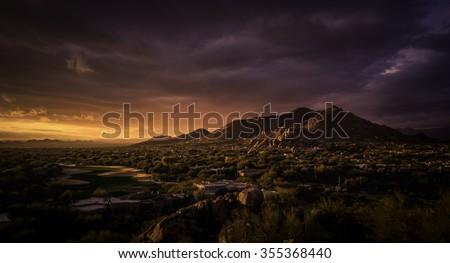 Golden dramatic sunset over North Scottsdale,Arizona,USA - stock photo