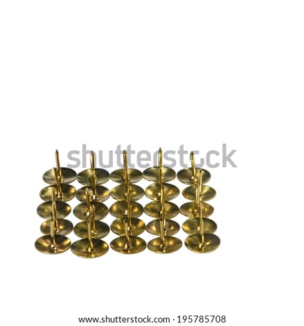 Golden drawing pins laid out by a square up an edge