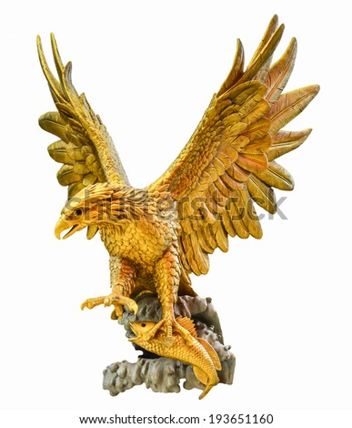 golden eagle statue isolated on black background - stock photo