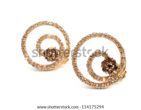 Golden earrings - stock photo