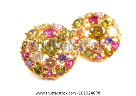 Golden earrings with colorful gems, over white - stock photo