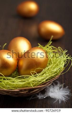 golden easter eggs - stock photo