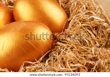 Golden Easter eggs in the nest over gold background