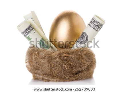 golden egg in a nest with dollars isolated on white background