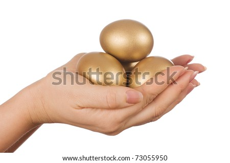 golden egg in the hand isolated - stock photo