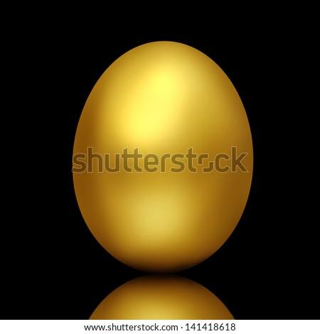 Golden egg on black background - stock photo