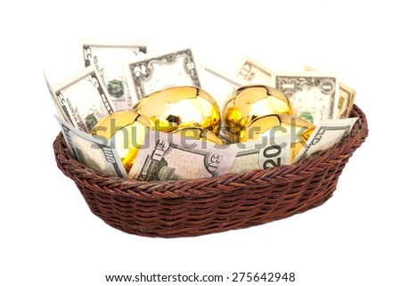 Golden eggs and dollars in basket isolated on white background - stock photo