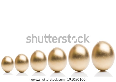 Golden eggs from small to large isolated on a white background. Concept of financial growth.