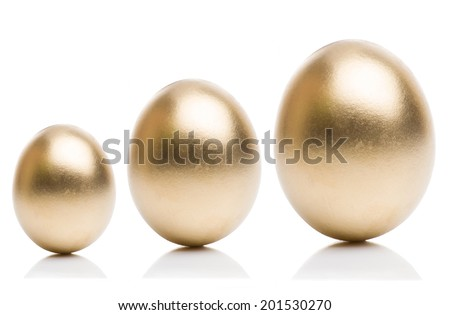 Golden eggs from small to large isolated on a white background. Concept of financial growth. - stock photo