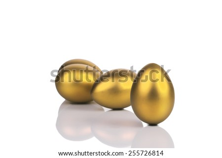 golden eggs on a white background - stock photo