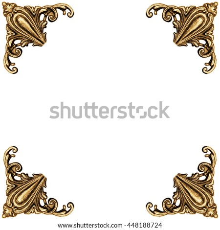 Golden elements of carved frame - stock photo
