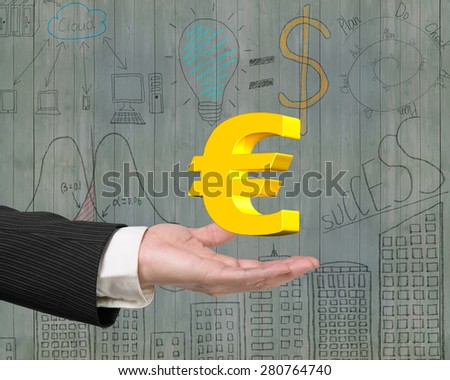 Golden euro sign in the male hand - stock photo