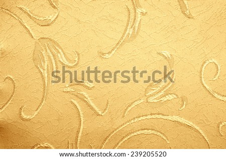 Golden fabric as background - stock photo