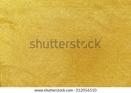 golden fabric texture close-up for abstract background - stock photo