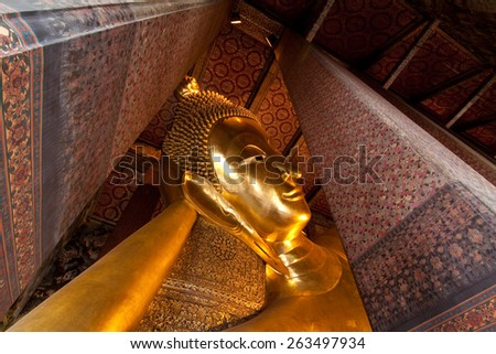 Golden face buddhist icon in temple - stock photo