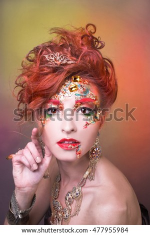 Golden fairy. Young woman in creative image.