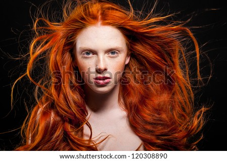 Golden Fashion Girl Portrait.Wavy Red Hair. Black Background - stock photo