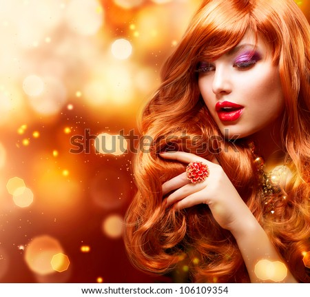 Golden Fashion Girl Portrait.Wavy Red Hair. Gold Blinking Background.Holiday - stock photo