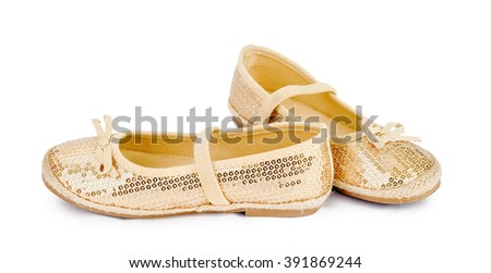 Golden fashion shoes on isolated white background