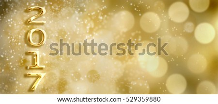 golden 2017 figures on bright bokeh background