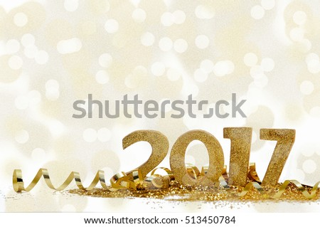 golden figures 2017 on glitter and bright bokeh background
