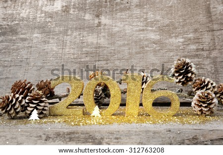 golden figures 2016 with text  Happy New  year (bonne annee in french) on wooden background - stock photo