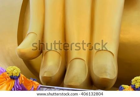 Golden finger of big buddha  - stock photo