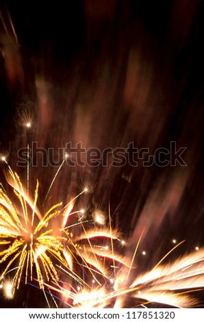 Golden fireworks burst and copy space suitable for New Year, 4th July, Bastille Day, wedding - stock photo