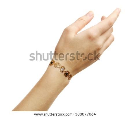 Golden flash tattoo on female wrist over white background - stock photo