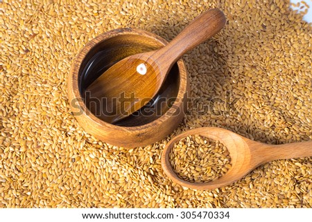 golden flax seed or linseed with flaxseed oil - stock photo