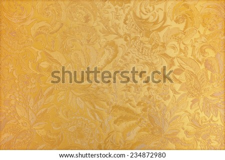 Golden floral ornament brocade textile pattern - stock photo