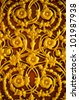 Golden flower pattern on the temple's door - stock photo