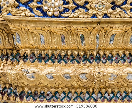 Golden flower pattern with glass mosaic on the church wall in the Thai temple. (Public area not required Property Release)