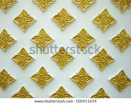 Golden Flowers Stucco the White Wall Background - stock photo