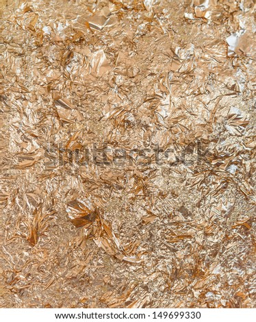 golden foil surface textured background - stock photo