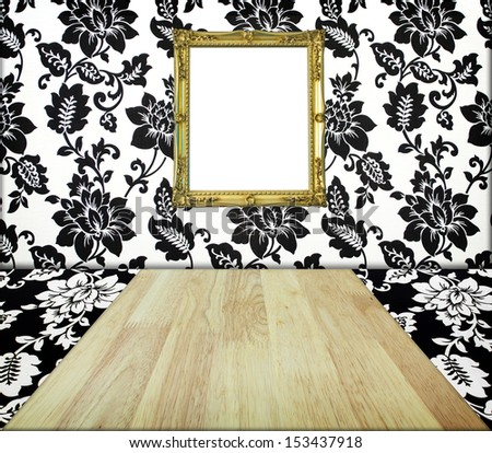 Golden frame at wall in imagination flower room - stock photo