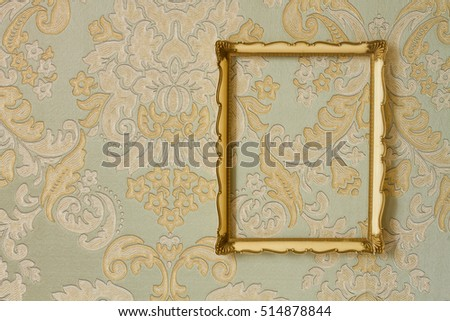 golden frame on the wall, vintage background