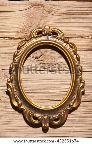 golden frame on wood texture background - stock photo