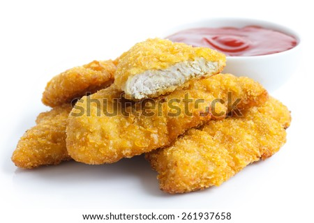 Golden fried chicken strips on white. With dish of ketchup. - stock photo