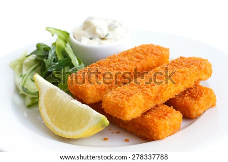 Golden fried fish fingers with lemon and tartar sauce. - stock photo