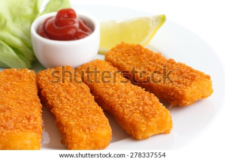 Golden fried fish fingers with lemon and tomato sauce. - stock photo