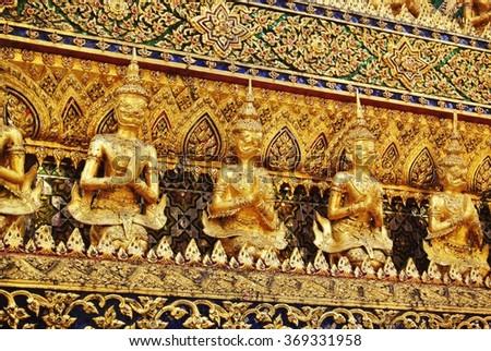 Golden garuda figures at the Grand Palace, Bangkok, Thailand - stock photo